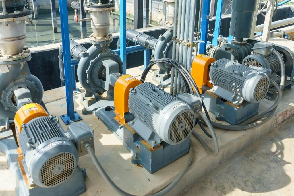 Electric motors driving water pumps of waste water treatment system